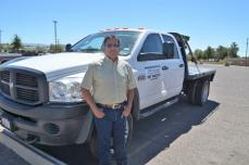 Acosta stands proudly by his truck