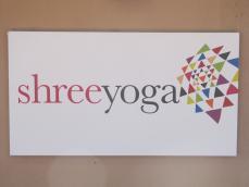 Shree Yoga sign on building exterior
