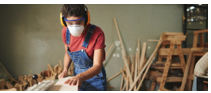 Woman cutting wood image
